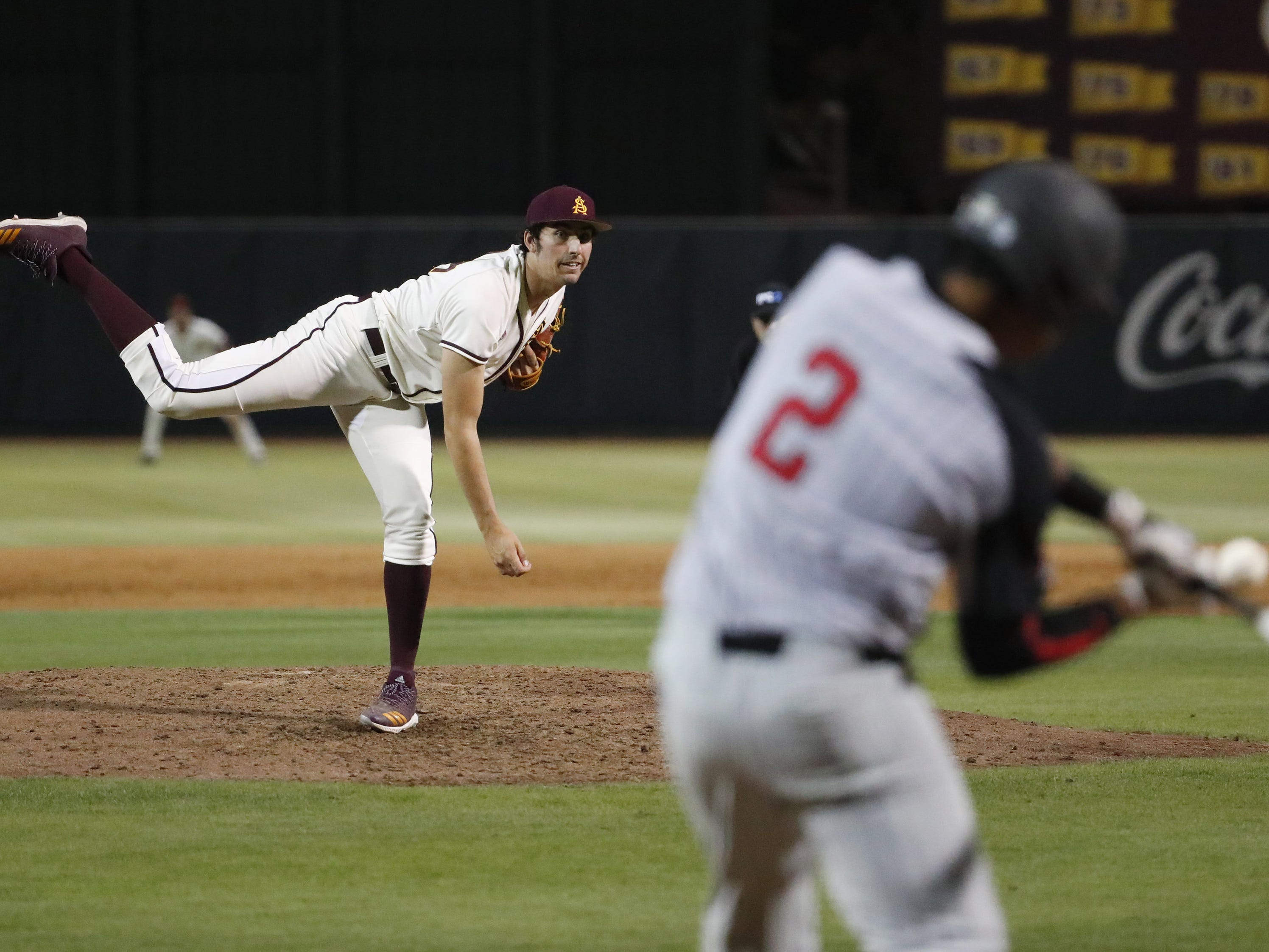 ASU pitchers Blake Burzell gets UNLV batter Edarian Williams to pop out during the sixth inning in Phoenix April 23, 2019.