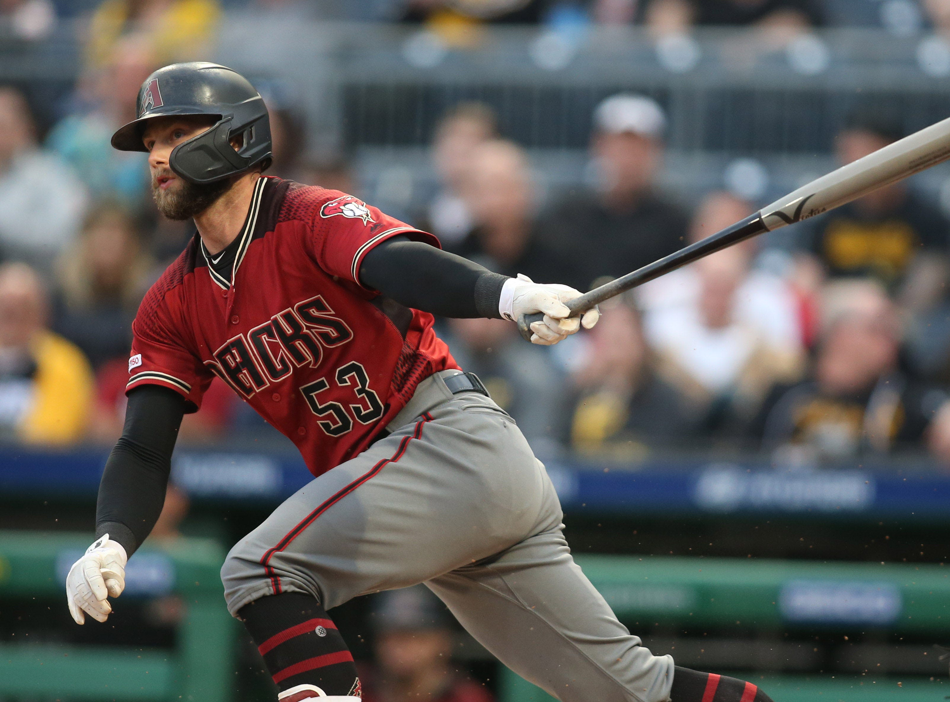 Apr 24, 2019; Pittsburgh, PA, USA; Arizona Diamondbacks first baseman Christian Walker (53) singles against the Pittsburgh Pirates during the first inning at PNC Park. Mandatory Credit: Charles LeClaire-USA TODAY Sports