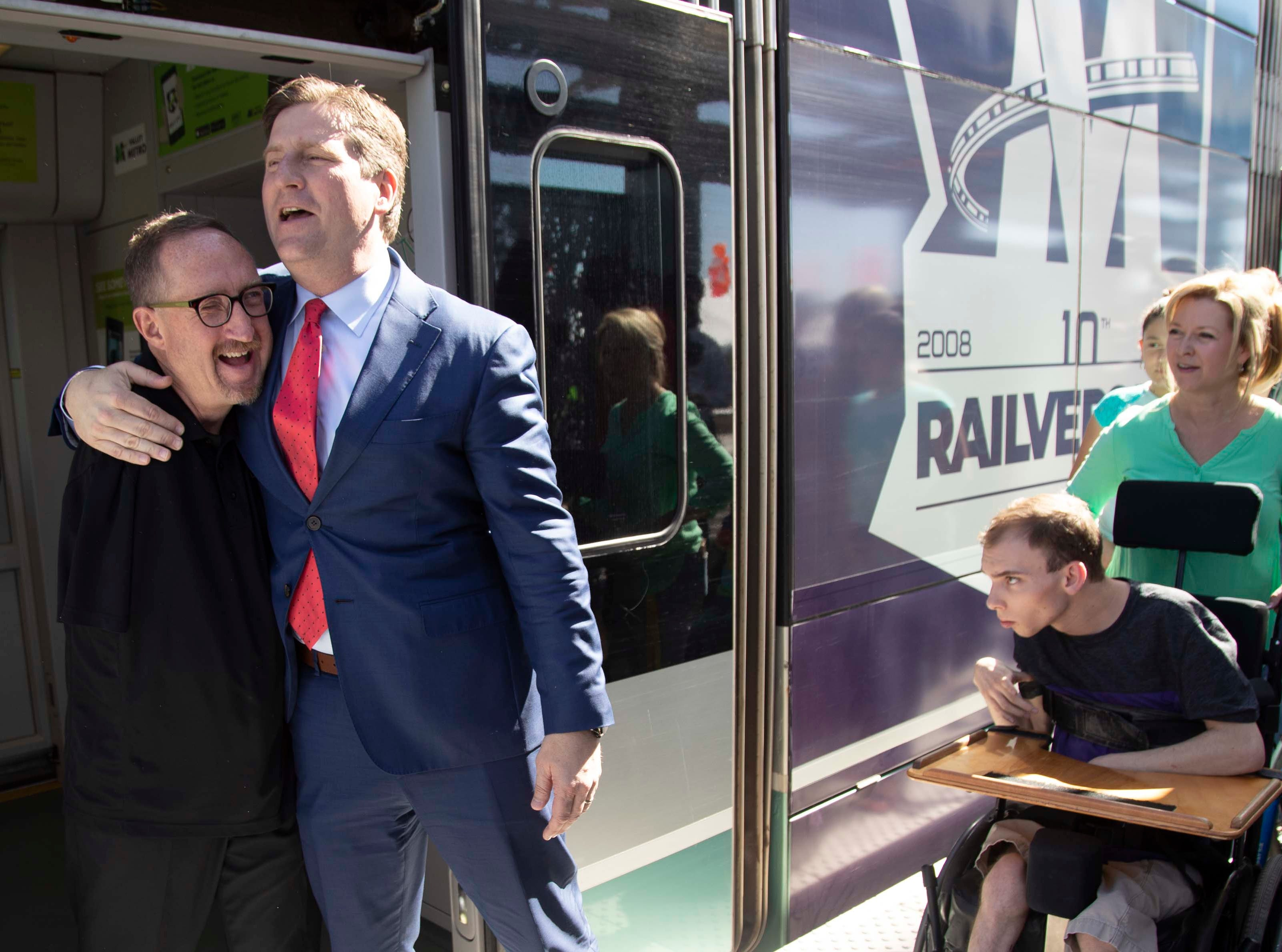 Congressman Greg Stanton welcomes Darrell Christensen and others as the light rail arrived at the 50th Street and Washington station, which will provide additional access to Ability 360, one of Arizona's largest disability resource centers.