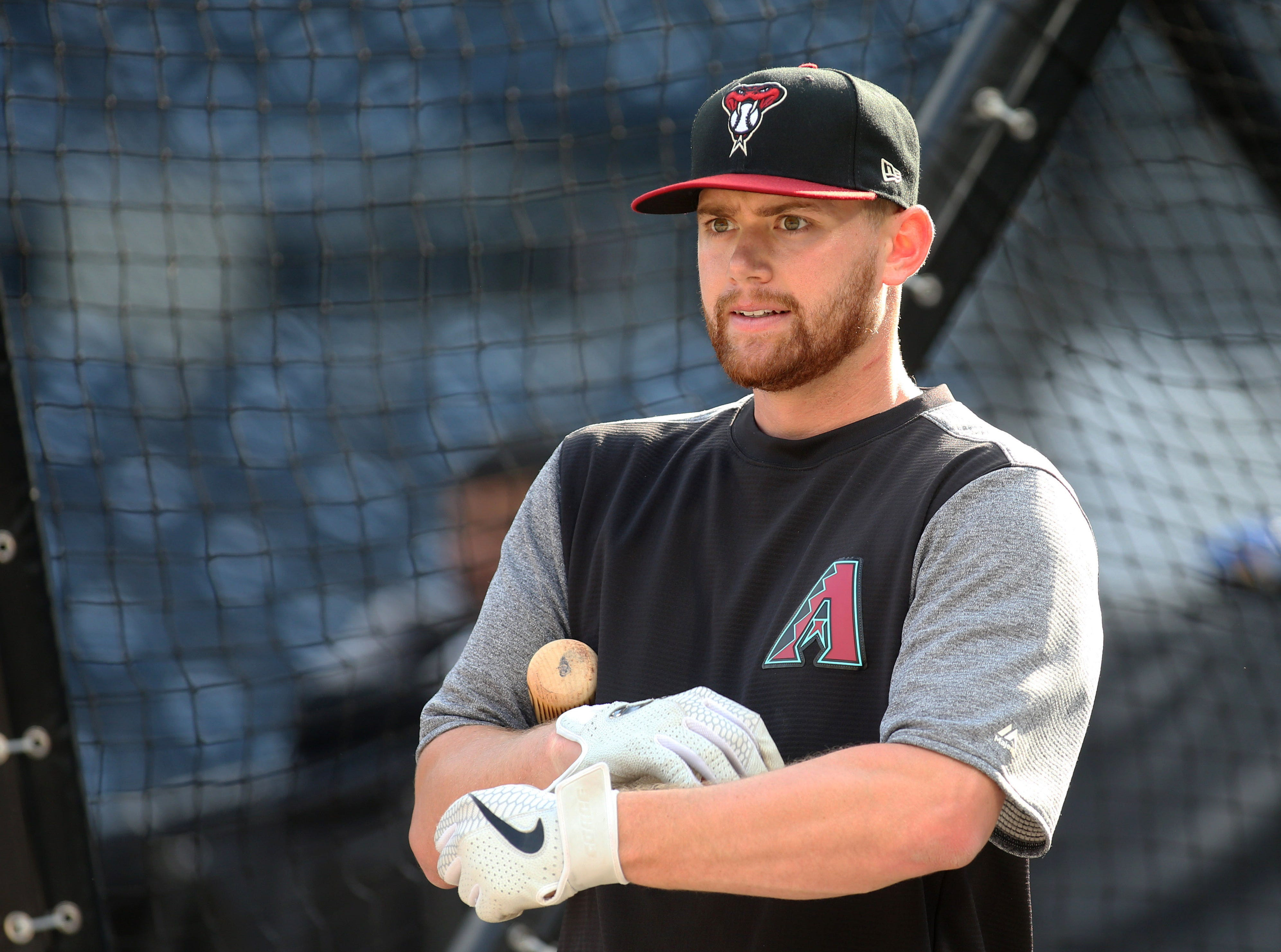 Apr 23, 2019; Pittsburgh, PA, USA;  Arizona Diamondbacks catcher Carson Kelly (18) looks on at the batting cage before playing the Pittsburgh Pirates at PNC Park. Mandatory Credit: Charles LeClaire-USA TODAY Sports