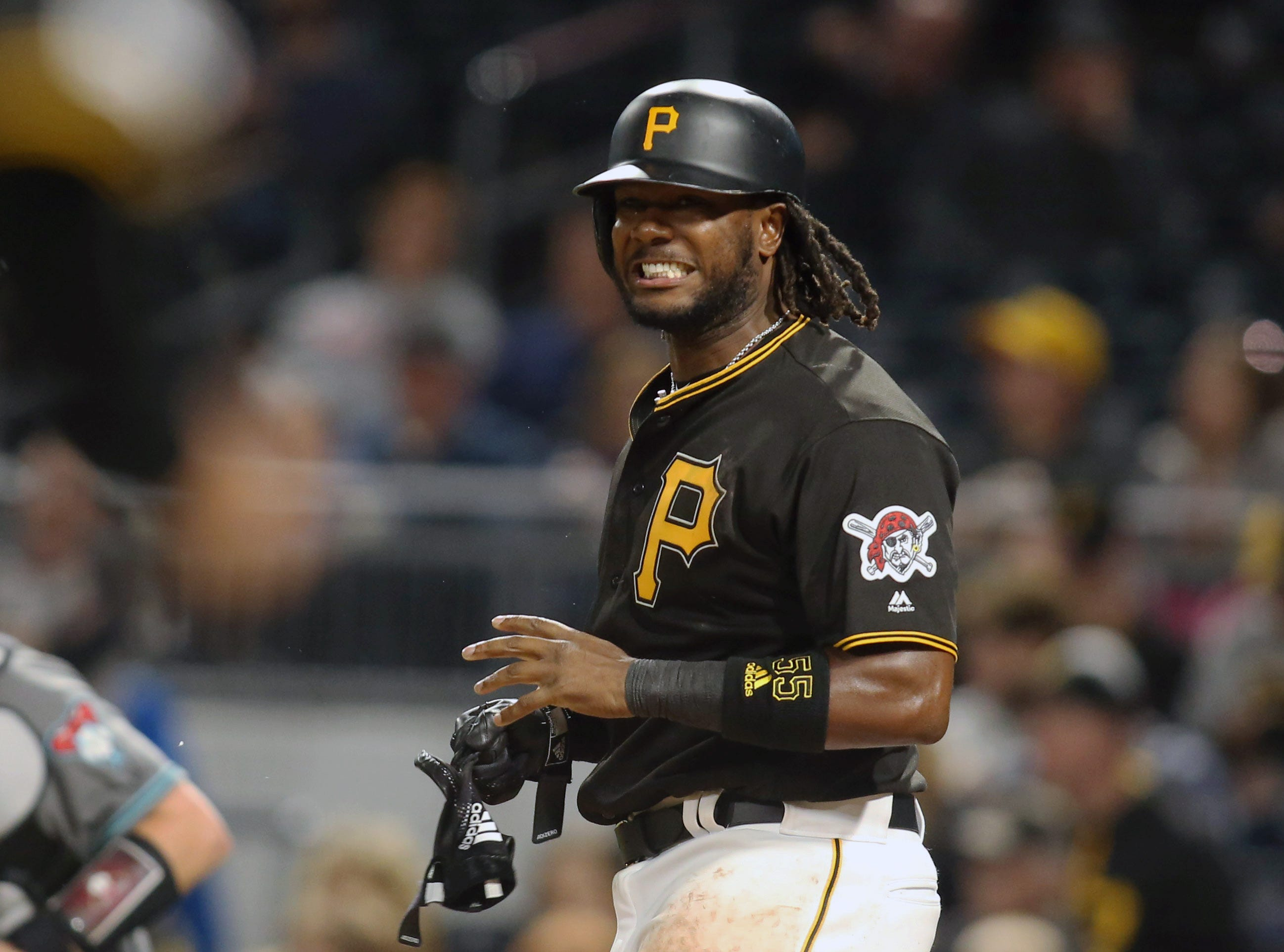 Apr 23, 2019; Pittsburgh, PA, USA;  Pittsburgh Pirates first baseman Josh Bell (55) reacts after striking out with men on base to end the eighth inning against the Arizona Diamondbacks at PNC Park. Mandatory Credit: Charles LeClaire-USA TODAY Sports