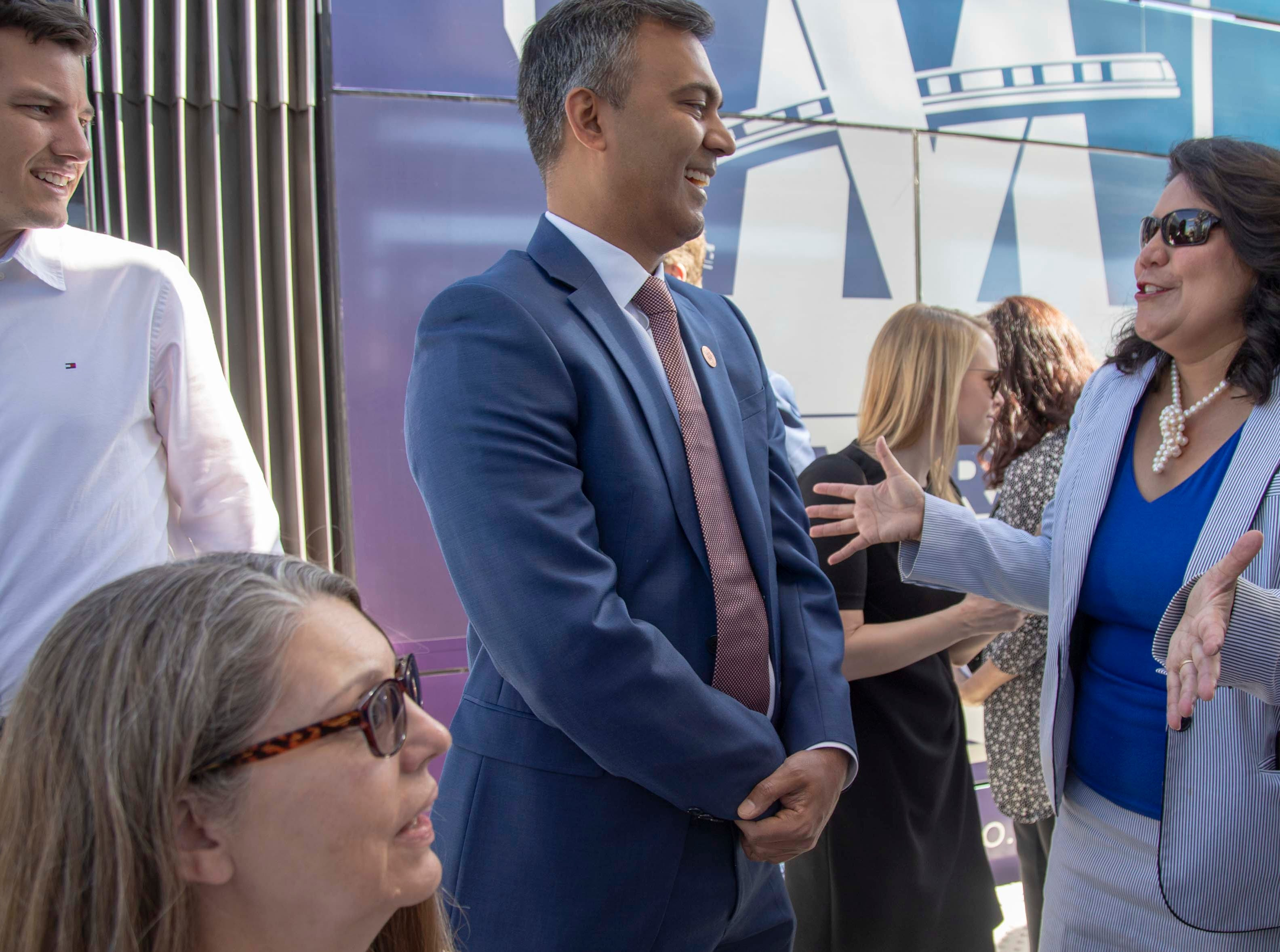 State Rep. Amish Shah, D-Phoenix, talks with Councilwoman Laura Pastor during Phoenix and Valley Metro's unveiling of the new 50th Street and Washington light rail station, which will provide additional access to Ability 360, one of Arizona's largest disability resource centers.
