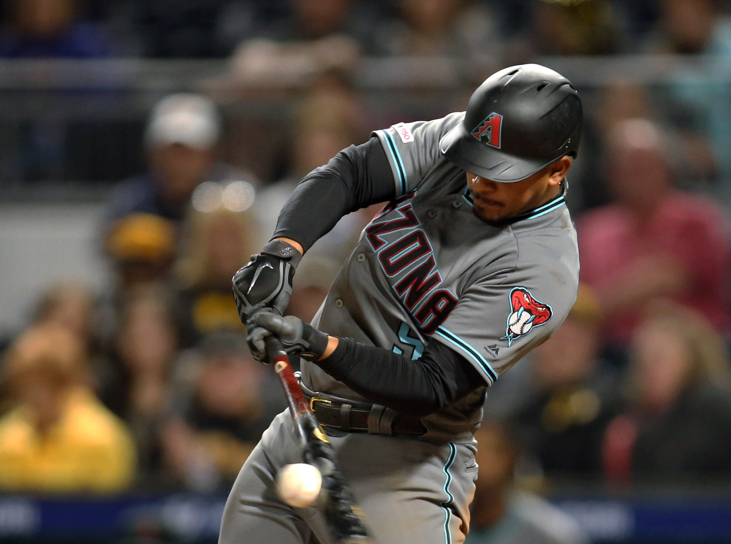 Apr 23, 2019; Pittsburgh, PA, USA; Arizona Diamondbacks third baseman Eduardo Escobar (5) singles against the Pittsburgh Pirates during the eighth inning at PNC Park. Mandatory Credit: Charles LeClaire-USA TODAY Sports