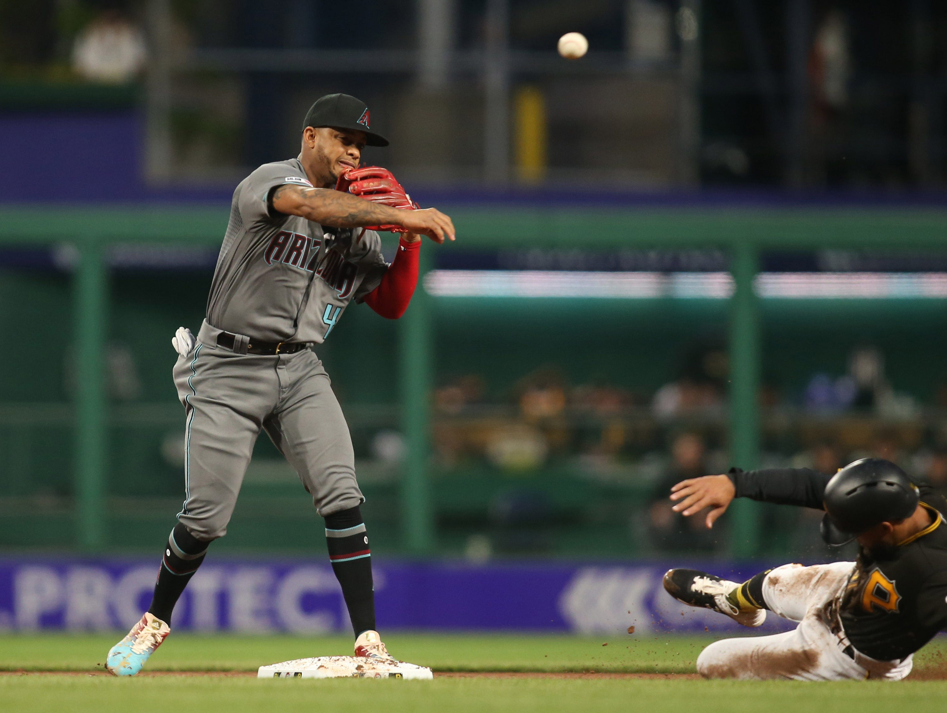 Apr 23, 2019; Pittsburgh, PA, USA;  Arizona Diamondbacks second baseman Ketel Marte (4) turns a double play over Pittsburgh Pirates center fielder Jason Martin (51) during the fourth inning at PNC Park. Mandatory Credit: Charles LeClaire-USA TODAY Sports