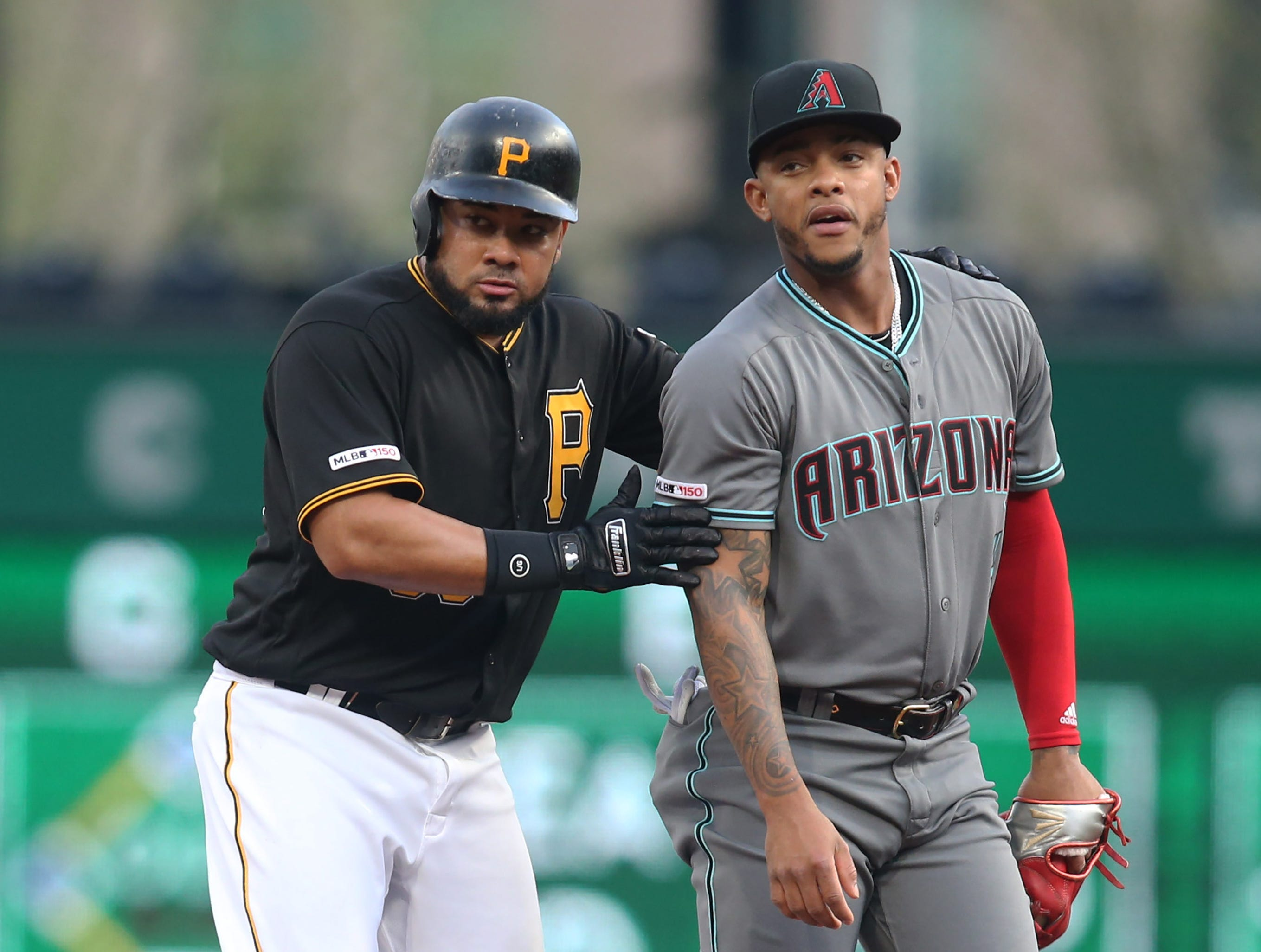 Apr 23, 2019; Pittsburgh, PA, USA;  Pittsburgh Pirates left fielder Melky Cabrera (53) reacts with Arizona Diamondbacks second baseman Ketel Marte (4) after hitting a double during the first inning at PNC Park. Mandatory Credit: Charles LeClaire-USA TODAY Sports