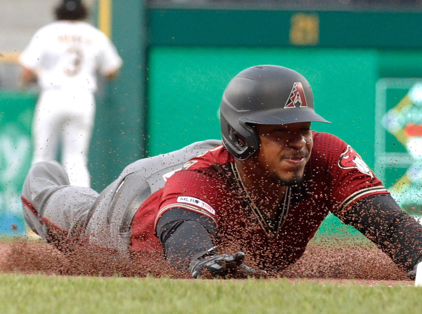 Apr 24, 2019; Pittsburgh, PA, USA; Arizona Diamondbacks third baseman Eduardo Escobar (5) slides into third base with a triple against the Pittsburgh Pirates during the first inning at PNC Park. Mandatory Credit: Charles LeClaire-USA TODAY Sports