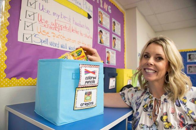 Whispering Wind Academy, 2nd Grade teacher shows her art supplies donation in her classroom.