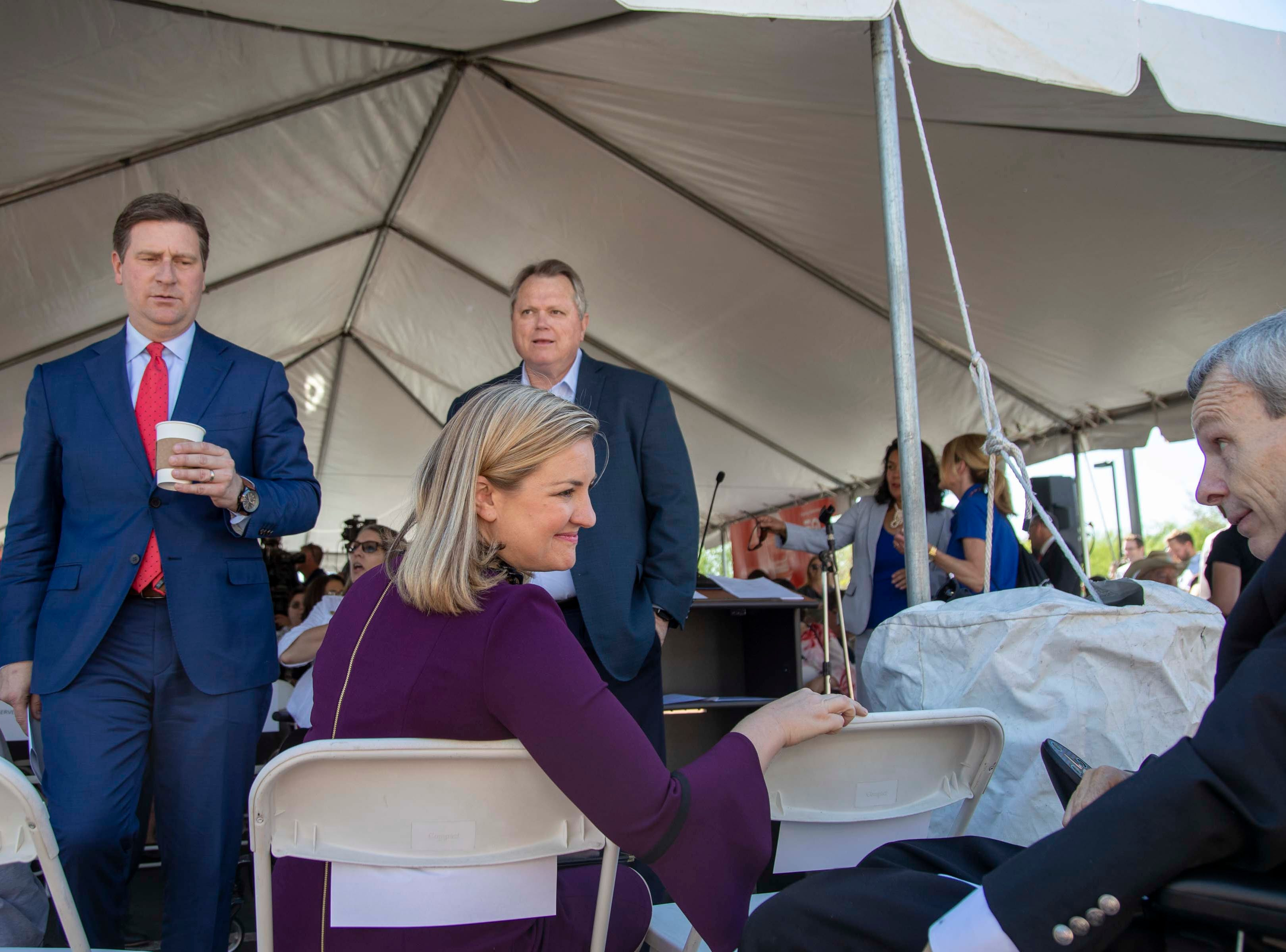 Phoenix Mayor Kate Gallego, talks to Phil Pangrazio, President and Chief Executive Officer of Ability360, during the unveiling the new light 50th Street and Washington rail station.