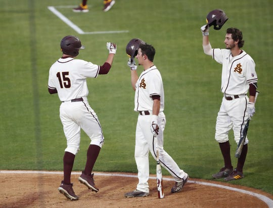 ASU's Erik Tolman (15) is congratulated after hitting a solo home run against UNLV during the second inning in Phoenix April 23, 2019.