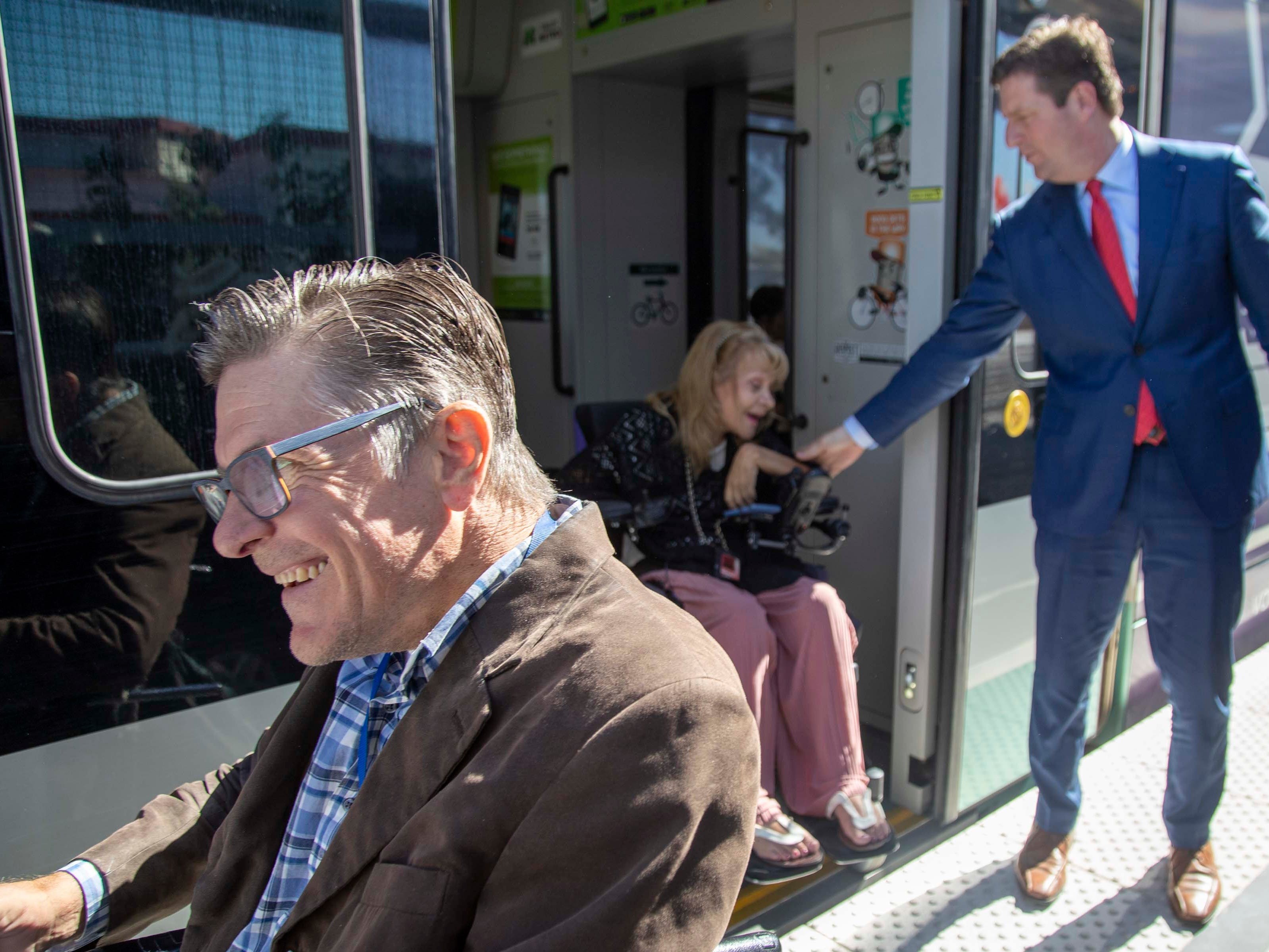 Congressman Greg Stanton (right) welcomes Donna Powers at the new 50th Street and Washington light rail station, which will provide additional access to Ability 360, one of Arizona's largest disability resource centers.