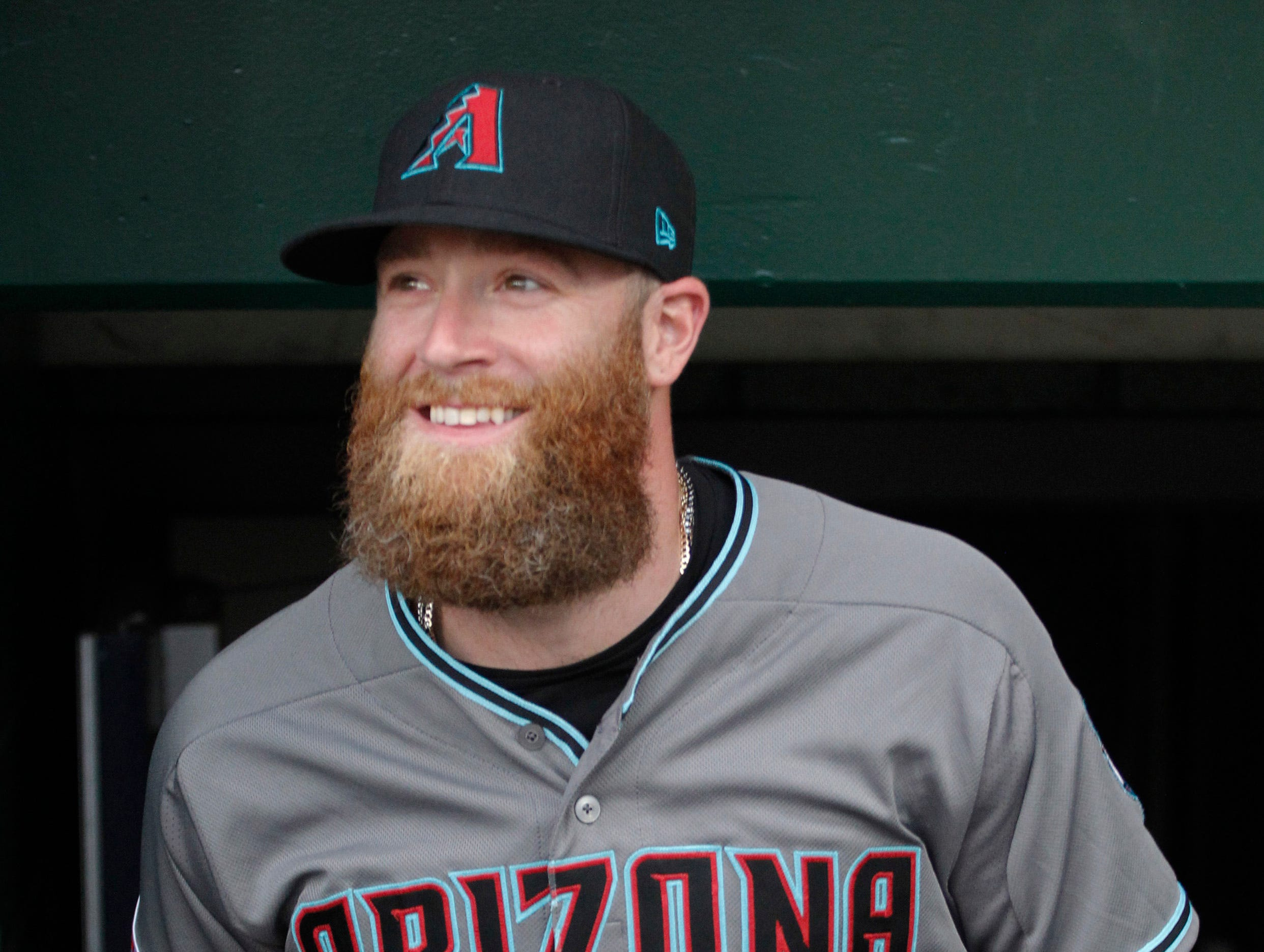 Apr 23, 2019; Pittsburgh, PA, USA;  Arizona Diamondbacks relief pitcher Archie Bradley (25) smiles as he enters the dugout to play the Pittsburgh Pirates at PNC Park. Mandatory Credit: Charles LeClaire-USA TODAY Sports