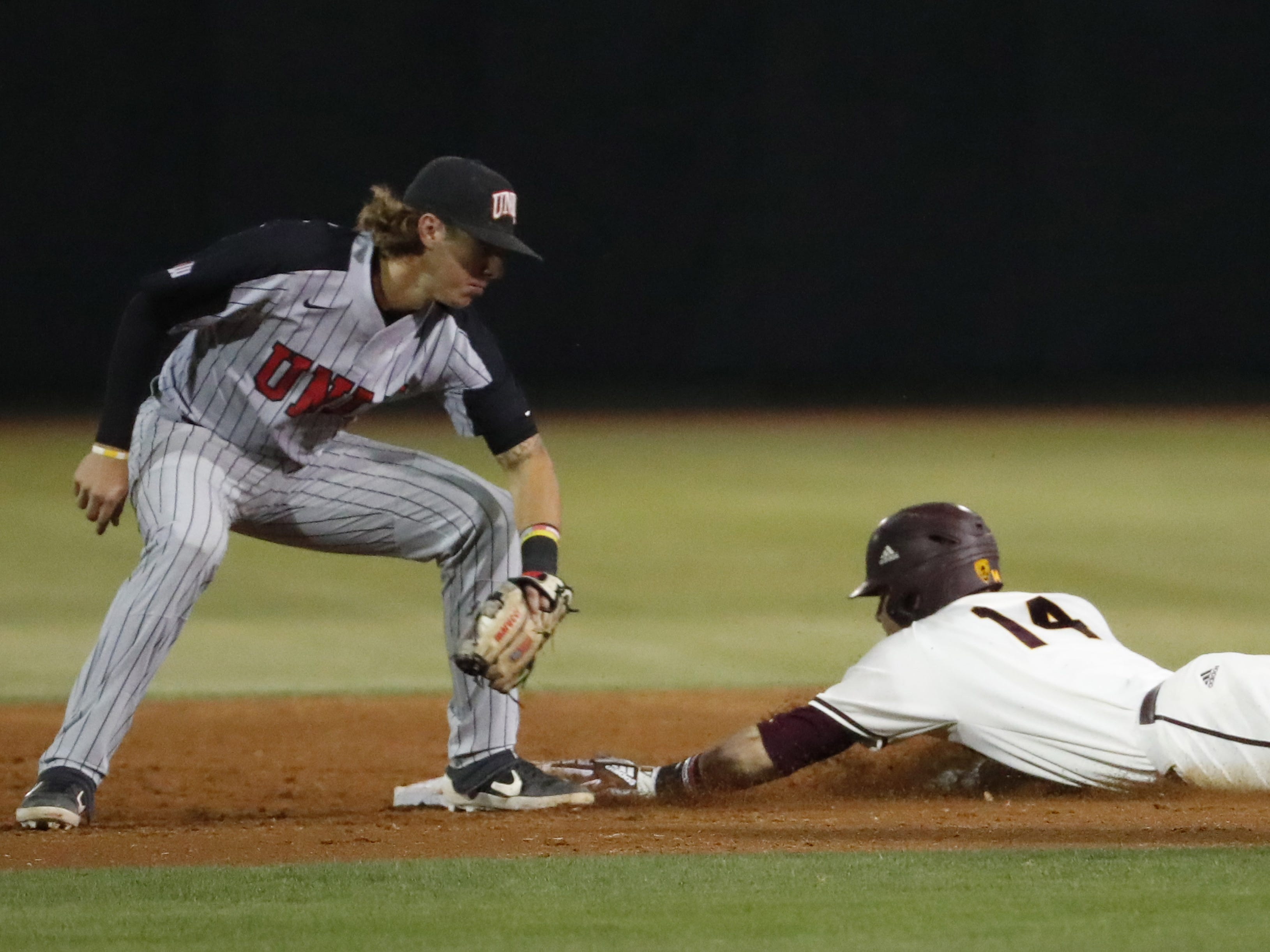 ASU's Gage Workman steals second base ahead of the tag by UNLV shortstop Bryson Stott during the third inning in Phoenix April 23, 2019.