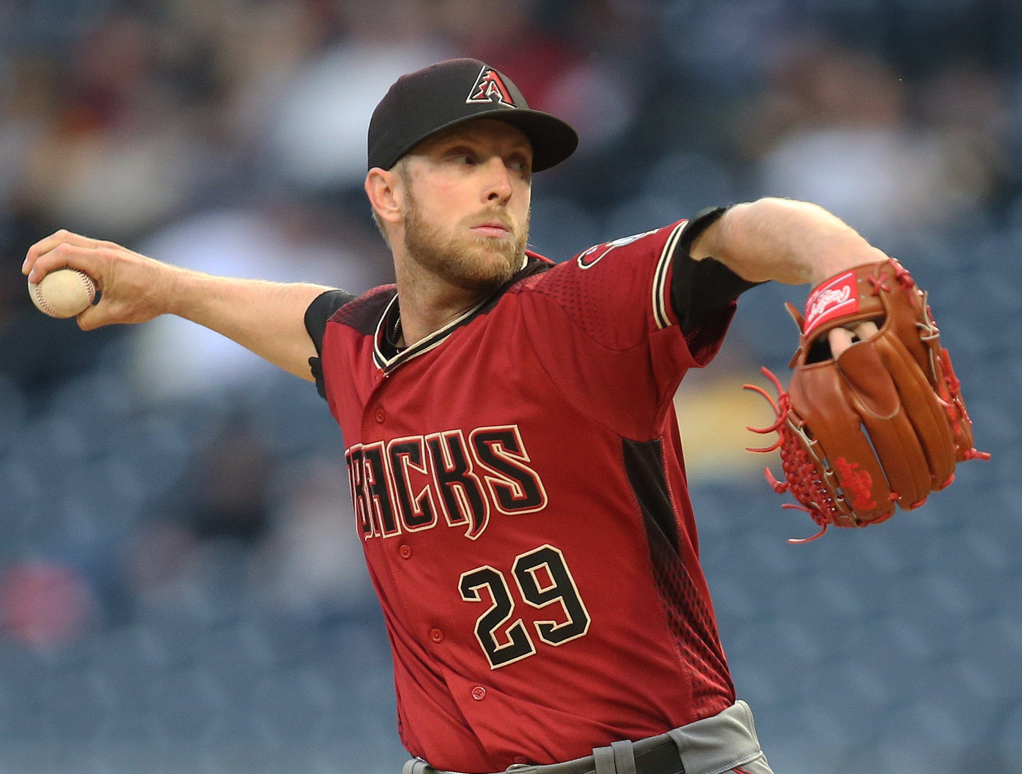 Apr 24, 2019; Pittsburgh, PA, USA; Arizona Diamondbacks starting pitcher Merrill Kelly (29) delivers a pitch against the Pittsburgh Pirates during the first inning at PNC Park. Mandatory Credit: Charles LeClaire-USA TODAY Sports