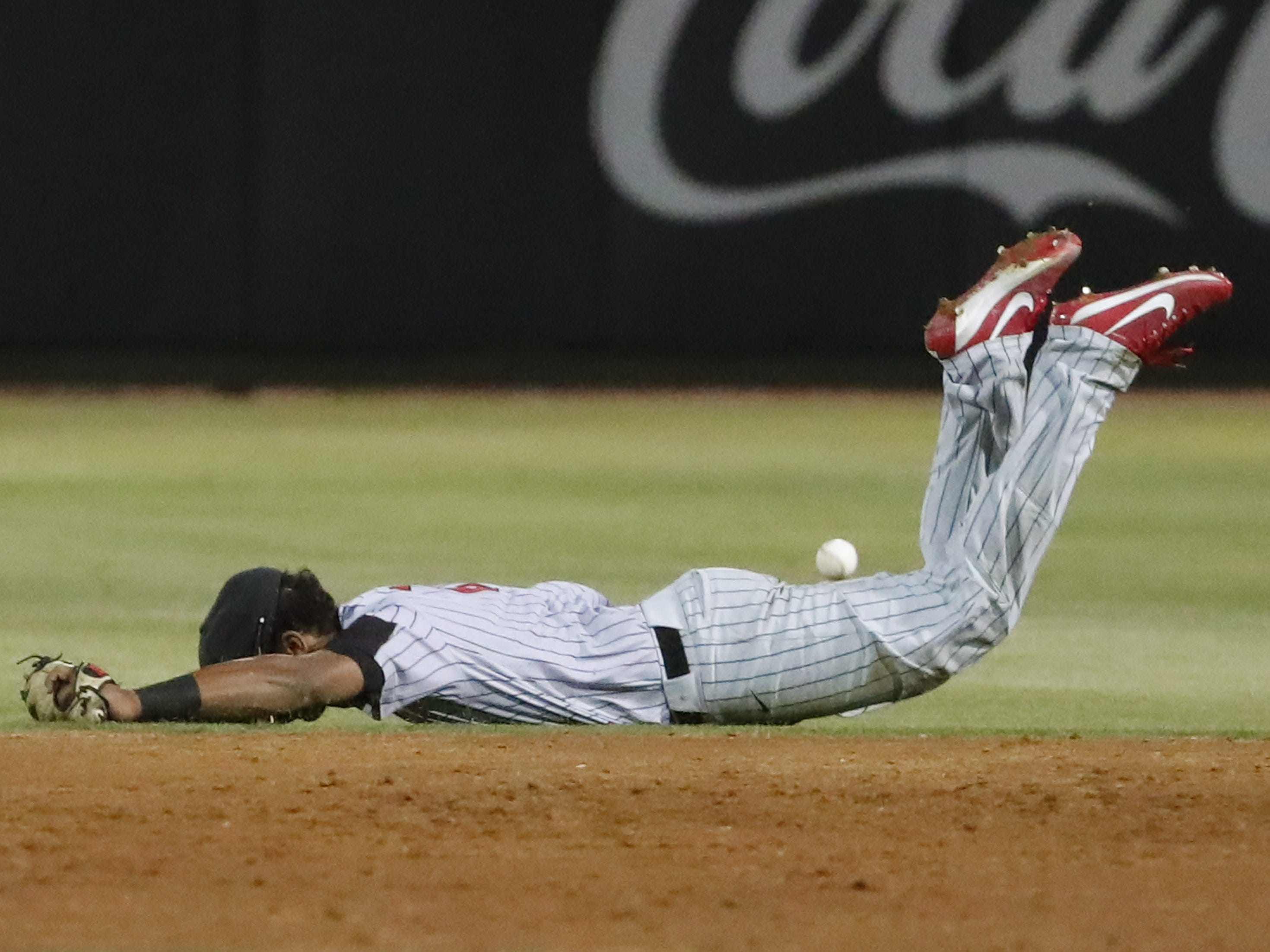 UNLV second baseman Adrian Williams dives for a base hit by ASU's Gage Workman during the third inning in Phoenix April 23, 2019.