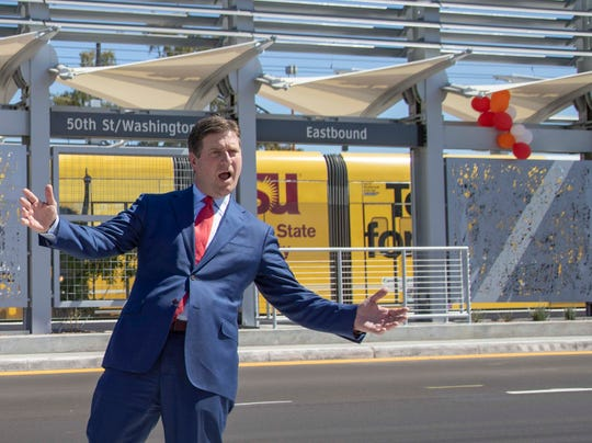 Congressman Greg Stanton cheers the light rail arrived at the new 50th Street and Washington station, which will provide additional access to Ability 360, one of Arizona's largest disability resource centers.
