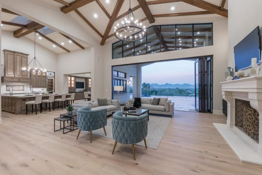 This Paradise Valley estate, sold by Fernando and Patricia Iacona, features exposed wood beams, retractable pocket doors and mountain views.