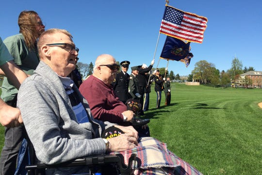 Earl Nicholas, front, and Peter Galvin, second from left, look on during Wednesday's Salute to Veterans pregame ceremony prior to the Cedar Crest-Hempfield game. NIcholas is a U.S. Army Korean Vet 1951-53, and Galvin is a Vietnam War vet who served from 1967-68.