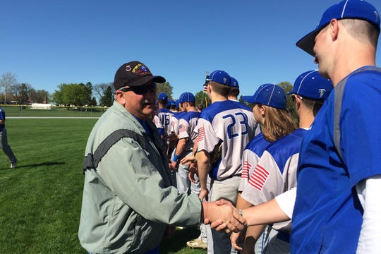 The Cedar Crest baseball team greets its guests of honor prior to Wednesday's Salute to Veterans game vs. Hempfield.