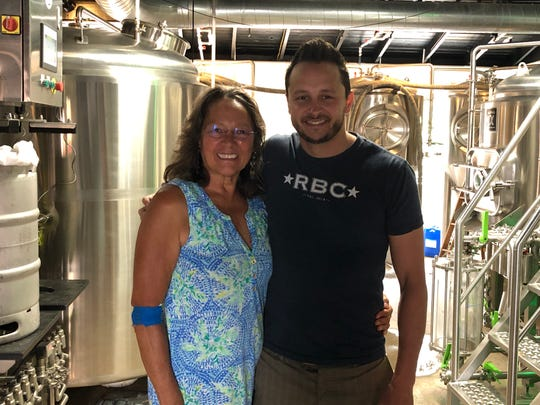 Mike Rotunda (right) poses with his mother, Lupe, inside Rotunda Brewing Company, which expanded operations in April 2018.