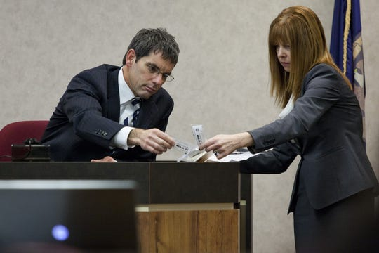 Mary Kelly, right, then-working as an assistant prosecuting attorney, look over evidence bags during a trial in 2015 in the courtroom of Judge Cynthia Lane. Kelly was recently named to the guardian ad litem position in St. Clair County, the contract for which was voted down by county commissioners during a board meeting April 18, 2019.