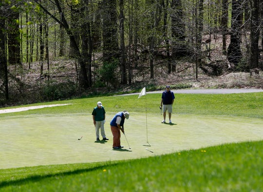A trio finish up a hole at Casperkill Golf Club in the Town of Poughkeepsie on April 24, 2019.