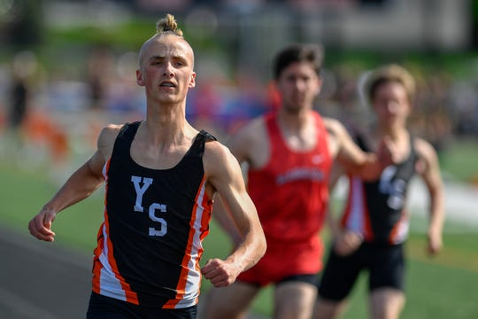York Suburban's Brooks Coughenour takes the win in the 100 dash, Tuesday, April 23, 2019.