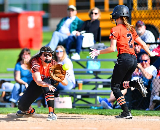 Central York's Emily Madzelan, left, catches the ball at first to out Northeastern's Brooke Frey during softball action at Central York High School in Springettsbury Township, Wednesday, April 24, 2019. Northeastern would win the game 3-2. Dawn J. Sagert photo