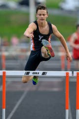 Andrew Paskey of York Suburban clears the final hurdle before the finish of the 110 hurdle event against Susquehannock, Tuesday, April 23, 2019. John A. Pavoncello photo