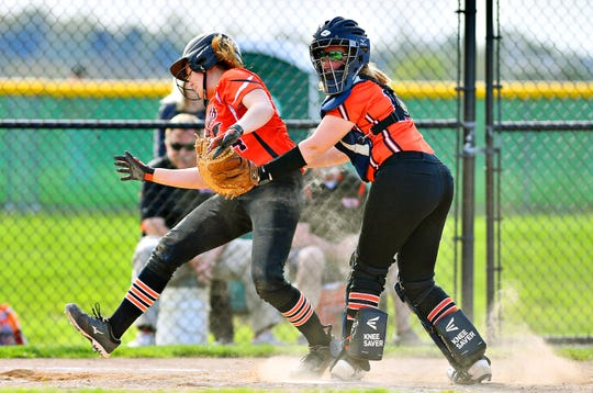 Northeastern's Megan Sweitzer, left, works to get past Central York's Emily Smith en route to home plate during softball action at Central York High School in Springettsbury Township, Wednesday, April 24, 2019. Northeastern would win the game 3-2. Dawn J. Sagert photo