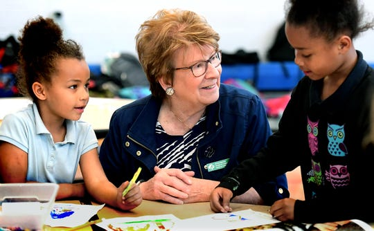 Girl Scout board member Betsy Keefer works on a project with Ferguson K-8 kindergartner Sanaa Brown, left, and her sister Imagine, during a STEAM after-school program at the school Wednesday, April 24, 2019. Girl Scouts in the Heart of Pennsylvania partnered with Martin Library to offer York City students access to its mobile programming through the district's after-school programs. Board members and sponsored joined the class Wednesday. Bill Kalina photo