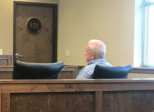 John G. Allen, a 75-year-old defrocked priest from York County, listens to the child sexual abuse charges against him during a preliminary hearing Wednesday in Dauphin County.