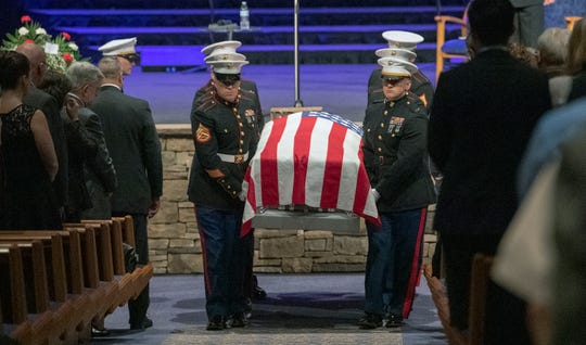 Marines carry the flag draped casket from the sanctuary after a memorial service for Staff Sgt. Benjamin Hines at Christian Life Assembly in Camp Hill.