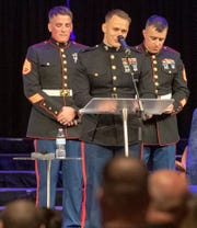 From the left, friends and fellow Marines Staff Sgt. Anthony Romberger, 2nd Lt. Anthony Owens and Staff Sgt. Brandyn Colton share memories of Staff Sgt. Benjamin Hines during his memorial service.