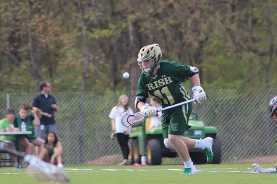 Pictured here in action Tuesday against Dover, York Catholic's Drew Snelbaker registered his 1,000th career faceoff win.