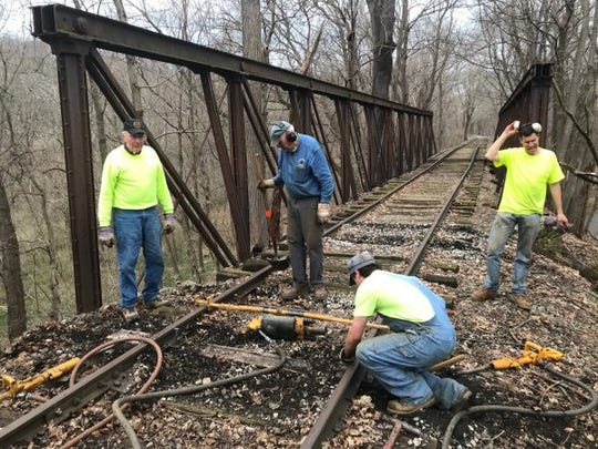 Crews work around the Valley Road Bridge on the Stewartstown Railroad. It is the single-oldest structure on the  railroad line. The Friends of the Stewartstown Railroad is seeking to raise the remaining funds needed to replace timbers.