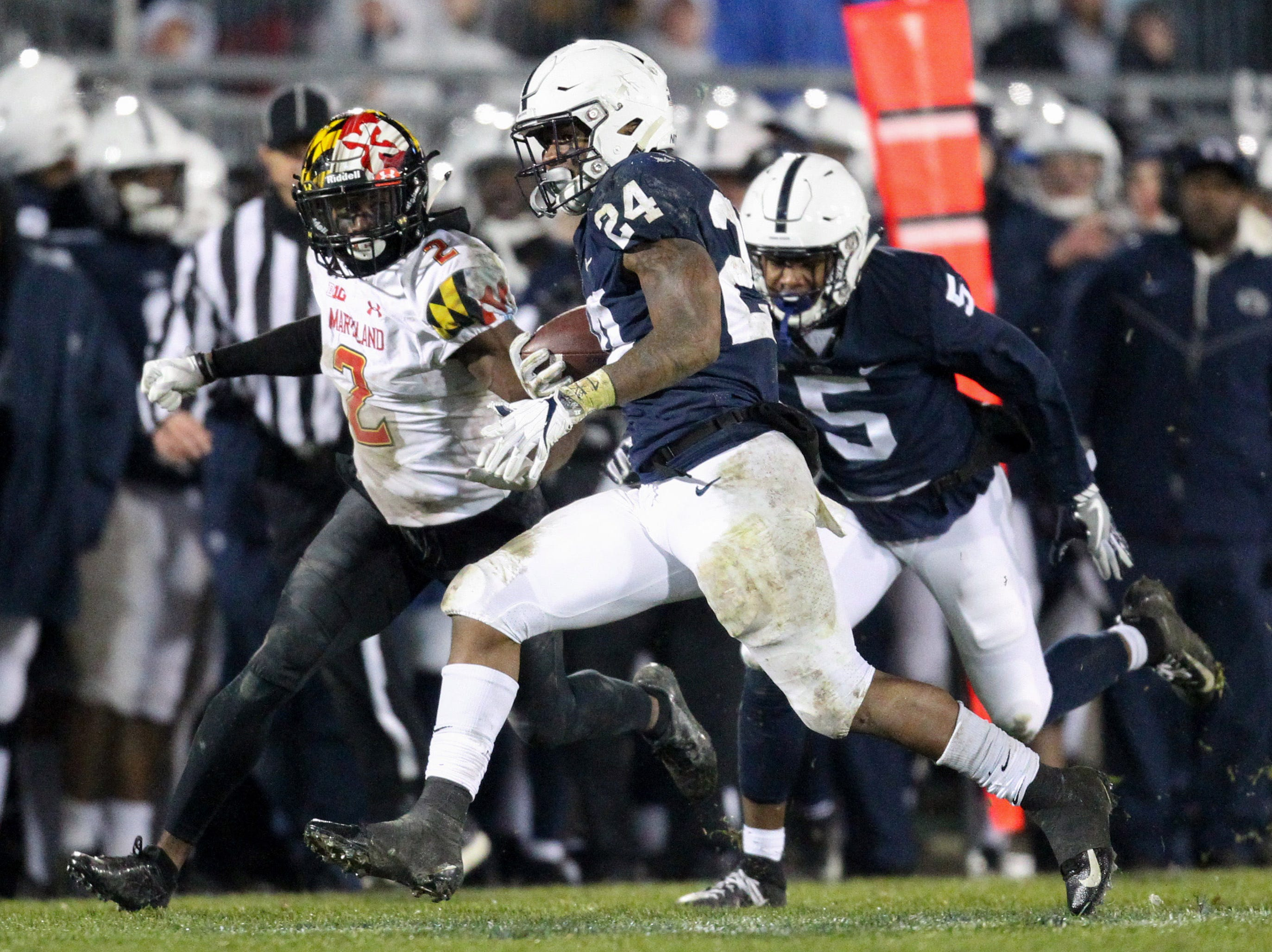 Nov 24, 2018; University Park, PA, USA; Penn State Nittany Lions running back Miles Sanders (24) runs with the ball during the third quarter against the Maryland Terrapins at Beaver Stadium. Penn State defeated Maryland 38-3. Mandatory Credit: Matthew O'Haren-USA TODAY Sports
