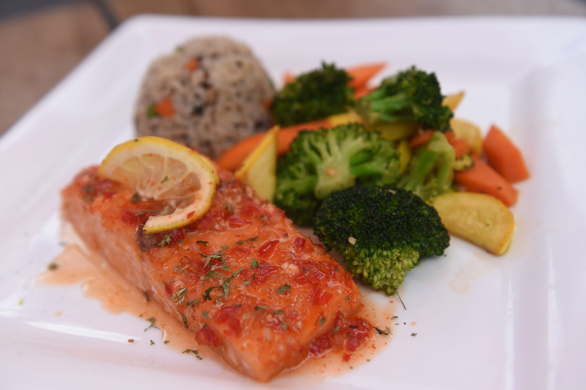 Baked salmon with Thai chili sauce is a new dish on the menu at Mustang Ranch Lounge, part of the Mustang Ranch brothel complex about 15 miles east of Reno.