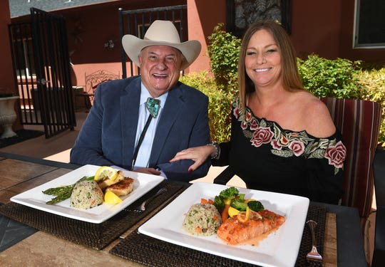 Lance Gilman, owner of the Mustang Ranch brothel, takes a moment before lunch with Jennifer Barnes, his companion and a Mustang Ranchl madam, on the poolside terrace of the complex.