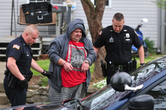 Travis L. Barker is escorted a Richmond Police Department vehicle Wednesday morning for transport to the Wayne County Jail.