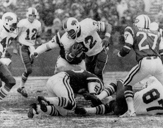 Paul Seymour, (87), the Buffalo Bills first round pick in the 1973 NFL draft, lies on the ground in the Dec. 16, 1973, game when O.J. Simpson broke the single-season NFL rushing record. The Buffalo Bills originally planned to use Seymour as an offense lineman. But he was converted back to a tight end, where he played five years for the Bills.