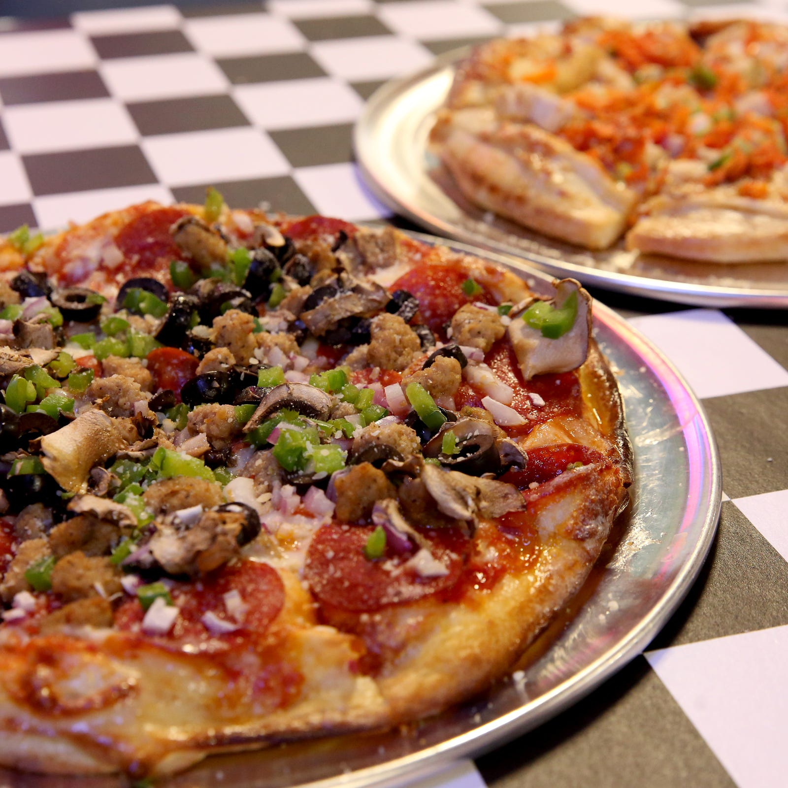 Pull over to Turn Here Bar & Grill, a new, car-themed pizza spot in Turner