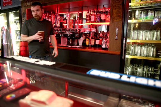 Kyle Koonce gets a beer for a customer at the Turn Here Bar and Grill in Turner on April 24, 2019. The former garage, converted into a pizza parlor opened April 10.