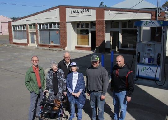 Turner city manager David Sawyer, Mirzel Ball, Turner Mayor Gary Tiffin, Valerie Ball, Pratum Co-Op manager Roy Mitchell and Turner Business coordinator D.J. Thommen pose in front of the former Ball Brothers property, at which the gas station is being reopened by Pratum for the first time in four years.