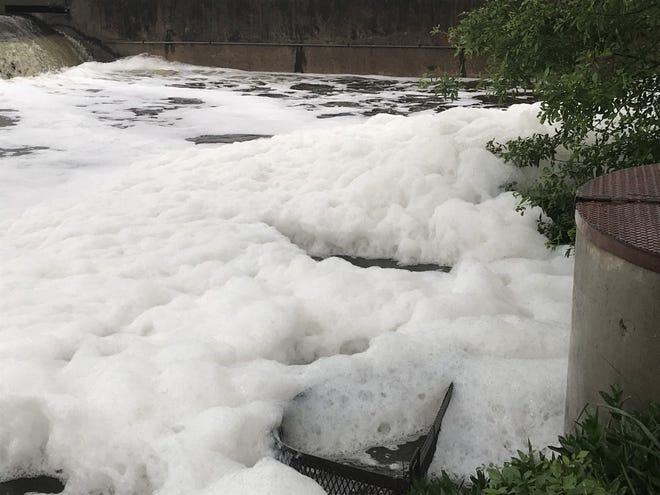 Foam rises in the Concho River after heavy rainfall Wednesday, April 24, 2019.