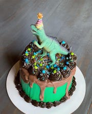 This chocolate dinosaur-themed cake was crafted by Sugar High Bake Shop.