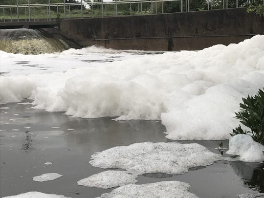 Foam rises after rainfall in the Concho River Wednesday, April 24, 2019.