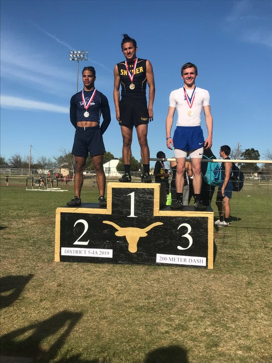 San Angelo Lake View High School's Elliot Peterson (right) is qualified to the Region I-4A Track and Field Meet in the boys long jump.