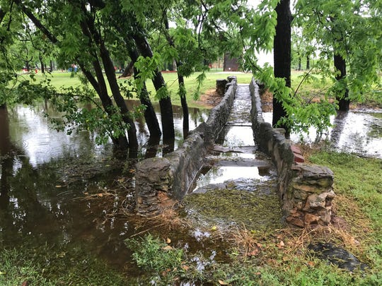 A bridge at Ballinger City Park was partially under water Wednesday, April 24, 2019, after thunderstorms moved through the area.