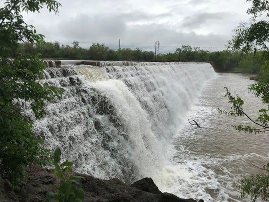 Elm Creek pours over the dam at Ballinger City Park on Wednesday, April 24, 2019.