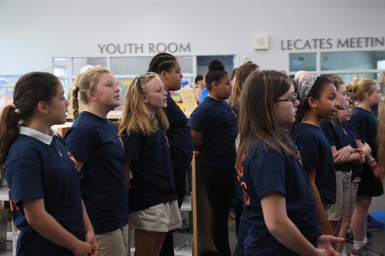 The Delmar Elementary school Singing Bobcats sang the national anthem during the Delmar Public library dedication ceremony on Wednesday, April 24, 2019.